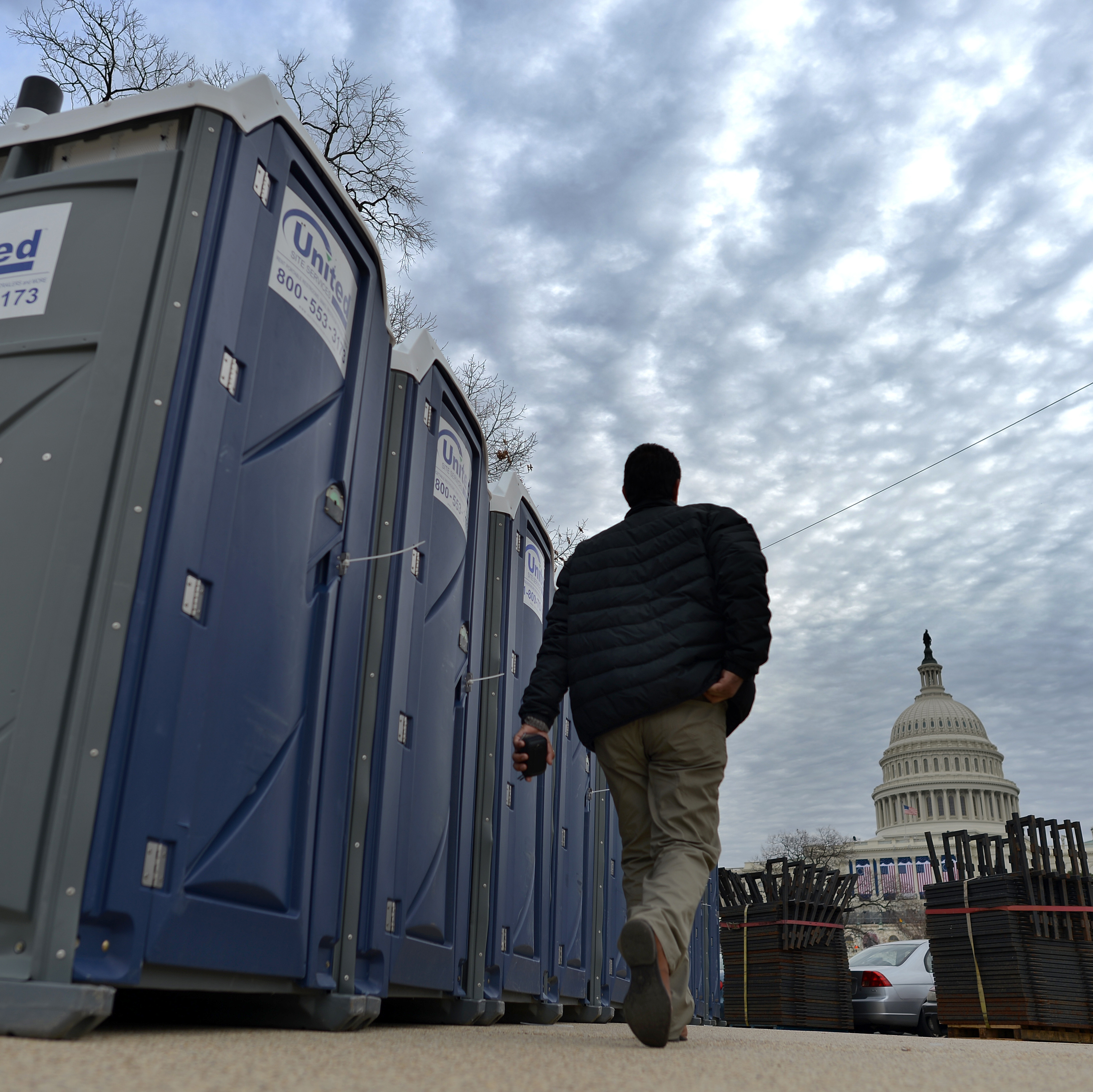 Portable toilets are installed around the U.S. Capitol in preparation for Monday's inauguration. A new app this year will help the crowd follow the event -- and even find the closest port-a-potty.