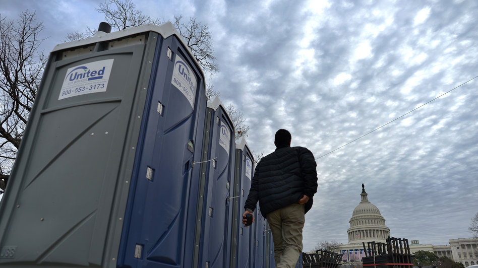 Portable toilets are installed around the U.S. Capitol in preparation for Monday's inauguration. A new app this year will help the crowd follow the event — and even find the closest port-a-potty. (AFP/Getty Images)