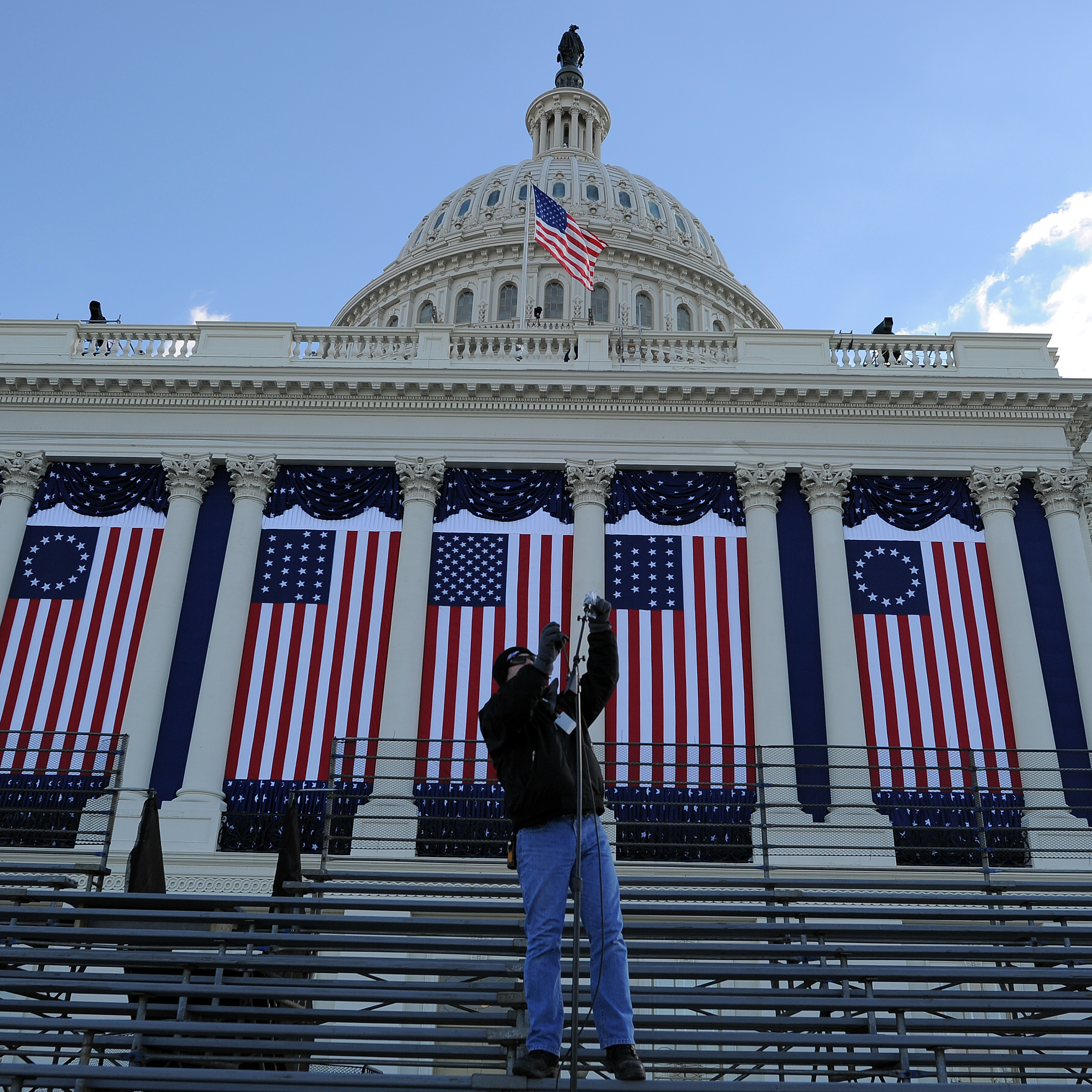 A worker sets up microphones at the U.S. Capitol as preparations continue for the second inauguration of President Obama on Friday.