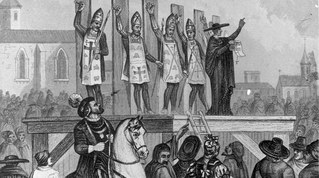 An illustration shows heretics being tortured and nailed to wooden posts during the first Inquisition. (Getty Images)