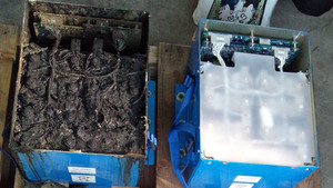 This photo, provided by the Japan Transport Safety Board, shows the distorted main lithium-ion battery and its lid, left, of the All Nippon Airways' Boeing 787, which made an emergency landing Wednesday in Japan. At right is the battery in normal condition.
