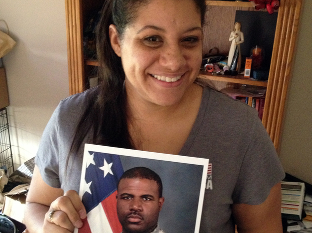 Alicia McCoy holds a photo of her husband, Sgt. Brandon McCoy. Despite taking part in basewide suicide prevention efforts at Fort Campbell in 2009, Sgt. McCoy took his own life in 2012. (Blake Farmer for NPR)