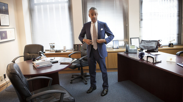 Rev. Al Sharpton, founder and president of National Action Network (NAN), prepares to leave its corporate office for the WWRL radio station in New York, January 11. (Shiho Fukada for NPR)