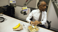 Sharpton eats his lunch, which consists of a banana, salad, and lemon tea before his radio show