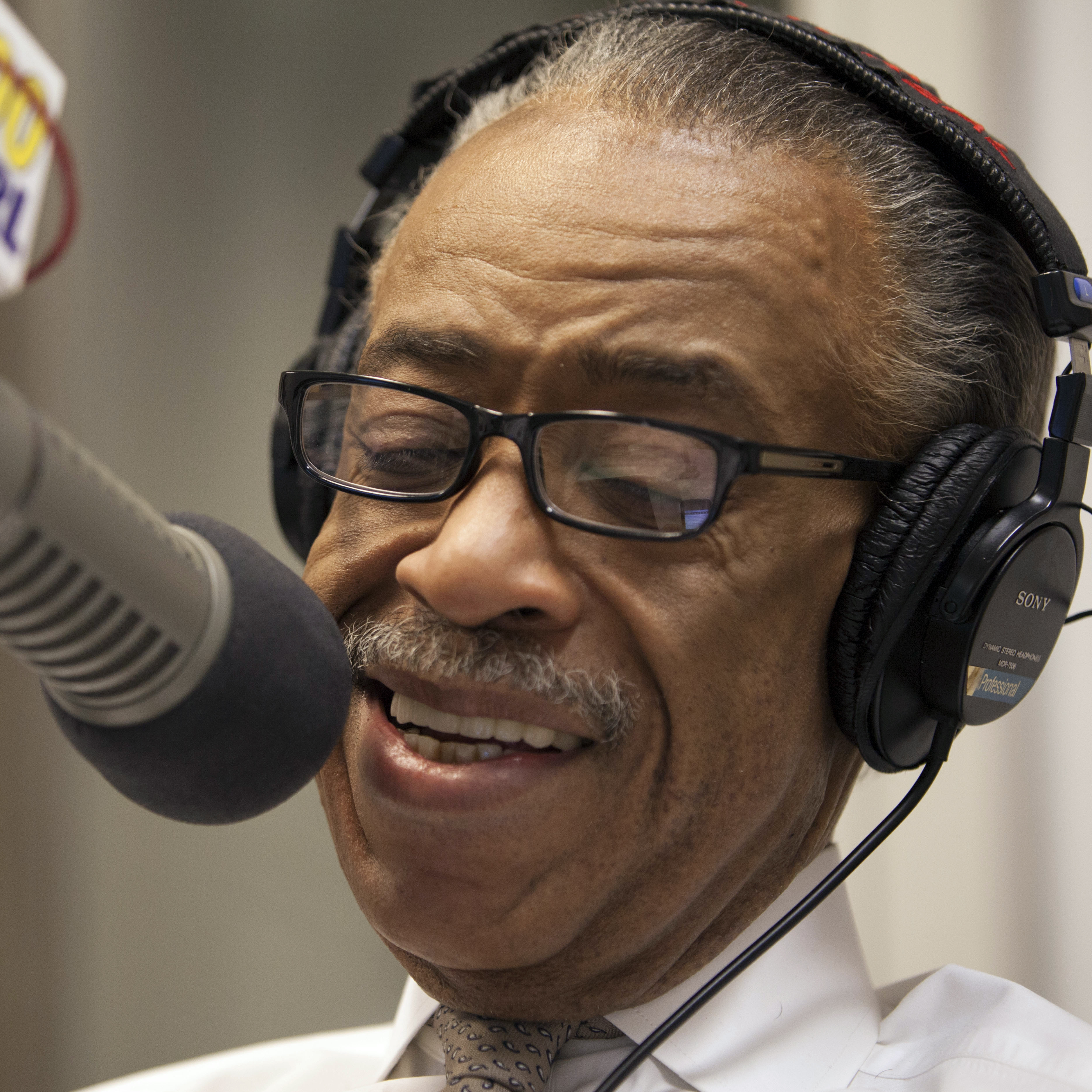 "Rev. Al Sharpton smiles during his radio show ""Keeping It Real with Reverend Al Sharpton"" in New York."