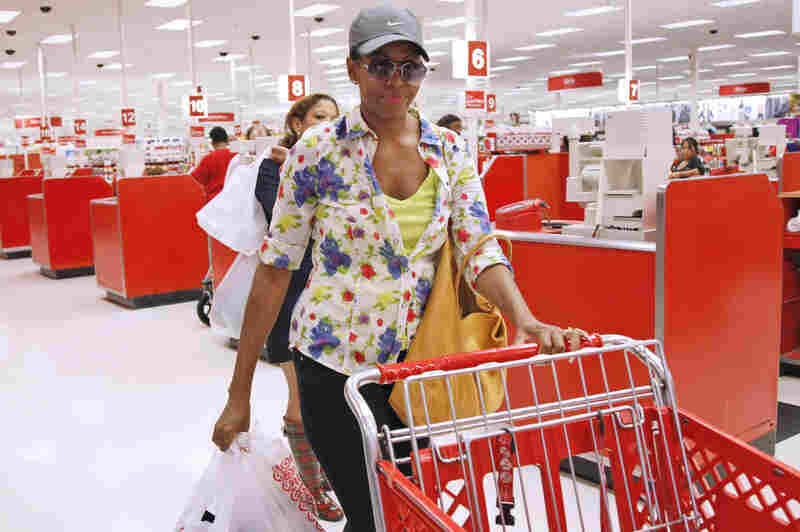 Typical American: Michelle leaves a Target department store in Alexandria, Va., after doing some shopping on Sept. 29, 2011. Her style choices range from expensive, high-end designers to discount stores like Target.