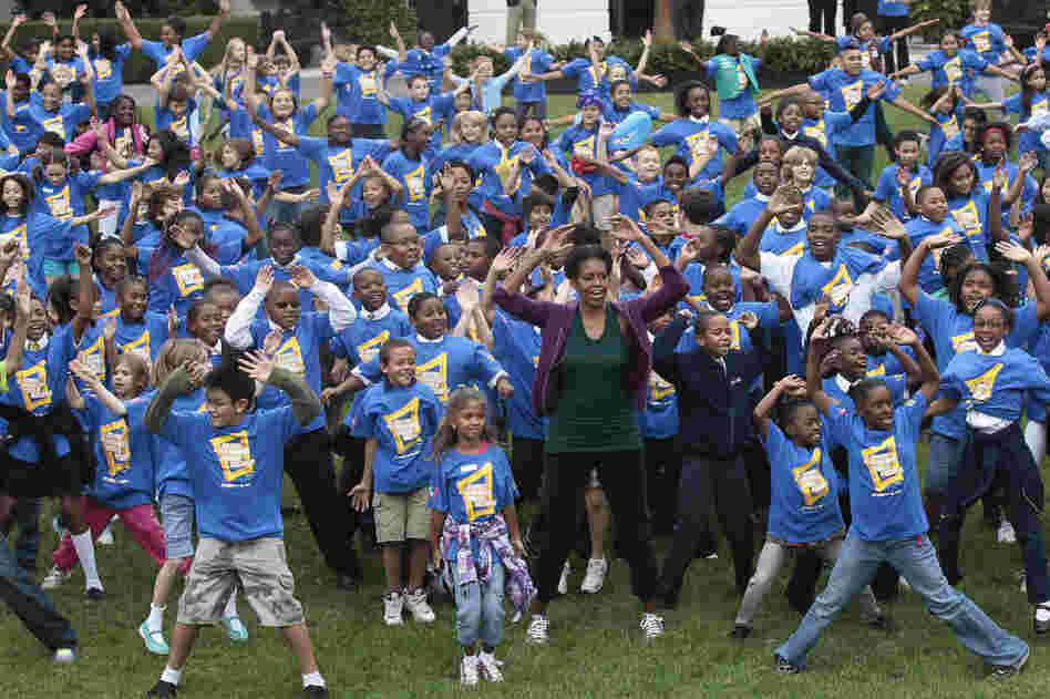 Let's move: Michelle and a group of children try to break the Guinness World Record for the most people doing jumping jacks in a 24-hour period, at the White House on Oct. 11, 2011. Michelle's anti-obesity campaign, Let's Move, focuses on teaching children good nutrition and regular exercise.