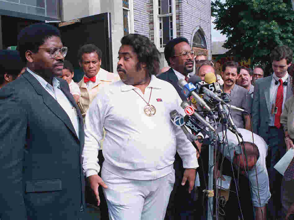 The Rev. Al Sharpton (center) holds a news conference with other advisers in the Tawana Brawley case in the Queens borough of New York in 1988.