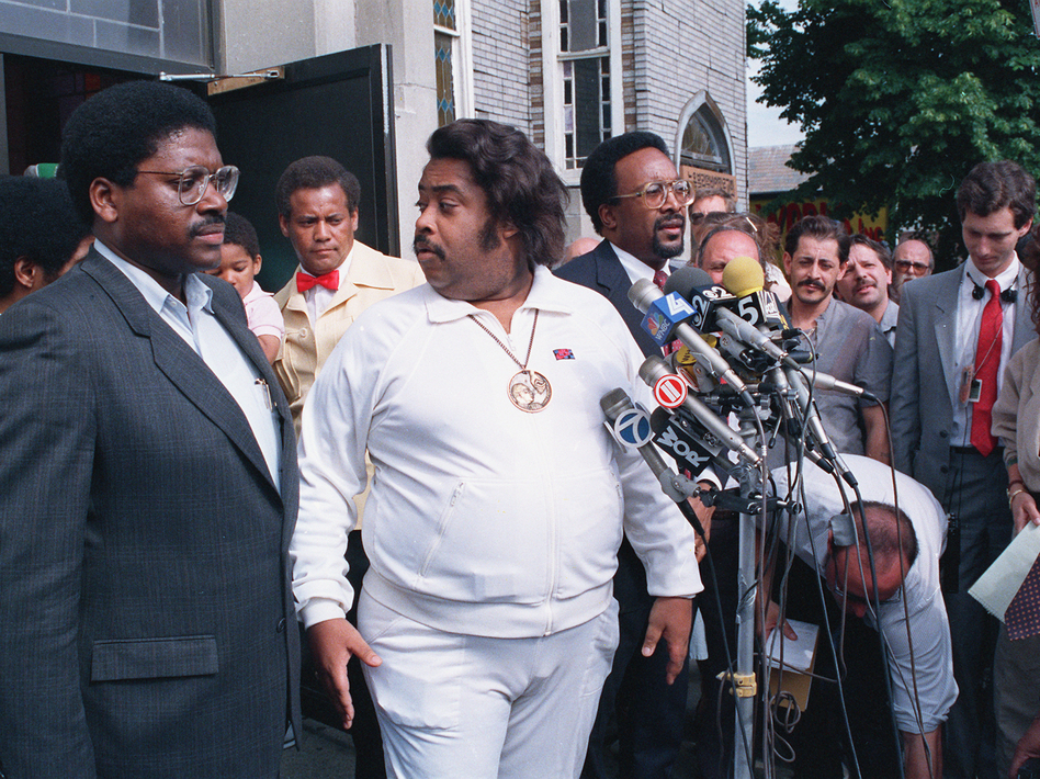 The Rev. Al Sharpton (center) holds a news conference with other advisers in the Tawana Brawley case in the Queens borough of New York in 1988. (AP)