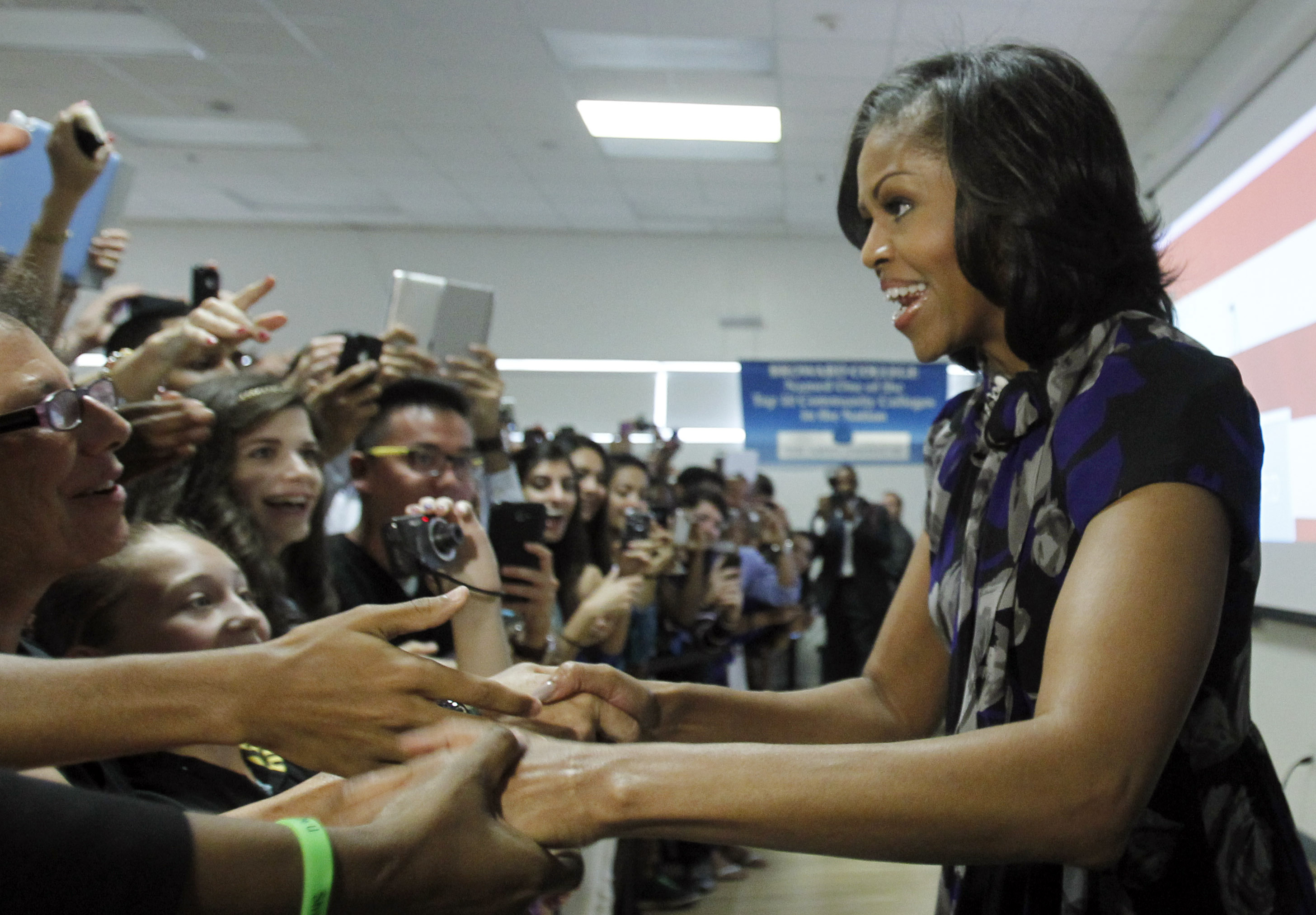 On the campaign trail: Michelle greets supporters at Broward College in Davie, Fla., on Oct. 22, 2012, where she rallied grass-root supporters and spoke of what's at stake in the election for Floridians. Michelle was seen as an asset on the campaign trail, where she often drew large crowds.