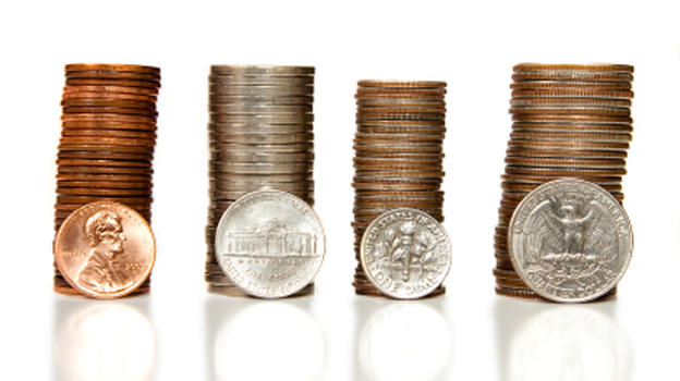 It costs more than a penny to make a penny, and more than a dime to make a nickel. Would it make better business sense to simply round up? (iStockphoto.com)