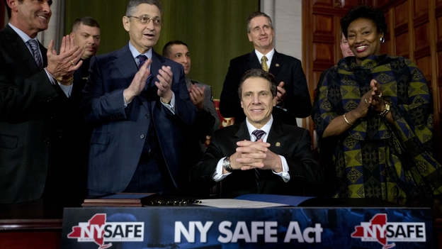 New York Gov. Andrew Cuomo signed a new gun control law in Albany on Tuesday. It's the nation's first gun law enacted since the December school shooting in Newtown, Conn. (AP)
