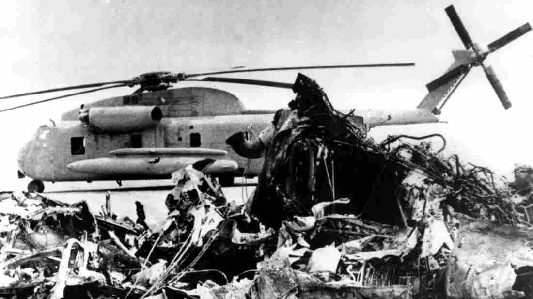 The remains of a burned-out U.S. helicopter and an abandoned chopper in the eastern desert of Iran on April 27, 1980, after the aborted American commando raid to free U.S. Embassy hostages.