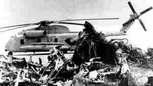The remains of a burned-out U.S. helicopter and an abandoned chopper in the eastern desert of Iran on April 27, 1980, after the aborted American commando raid to