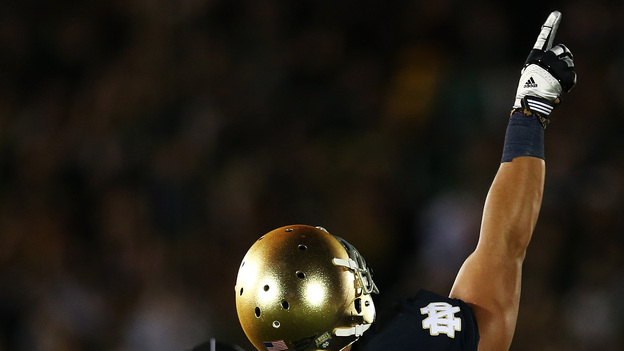 Manti Te'o, pointing skyward during Notre Dame's game against Michigan on Sept. 22. That was the day, he said then, of his girlfriend's funeral service. Now, he says he never met her and they had only an online and telephone relationship. (Getty Images)