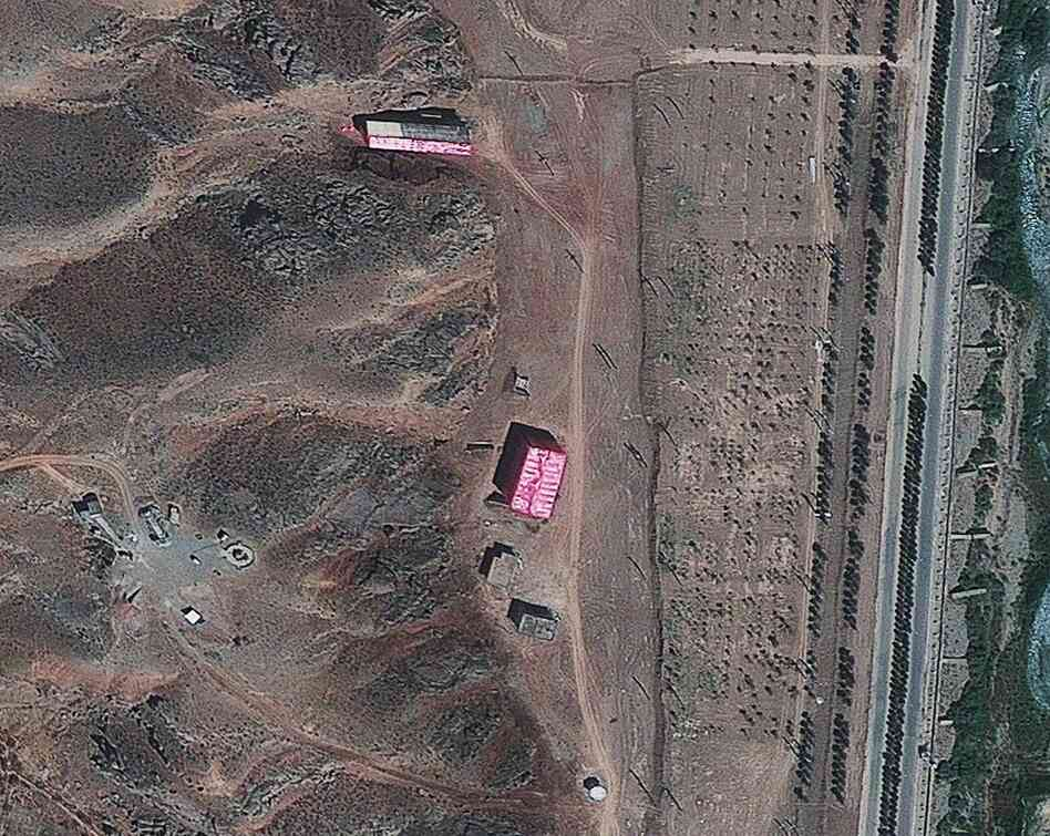 A photo from Aug. 15, 2012, supplied by the Institute for Science and International Security, shows buildings at the Parchin military base south of Tehran, Iran, shrouded in pink tarps. It's believed to be an effort to stop the U.N nuclear agency from monitoring the site, which is sus