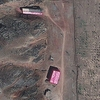A photo from Aug. 15, 2012, supplied by the Institute for Science and International Security, shows buildings at the Parchin military base south of Tehran, Iran, shrouded in pink tarps. It's believed to be an effort to stop the U.N nuclear agency from monitoring the site, which is suspected of being used for secret work on atomic weapons.