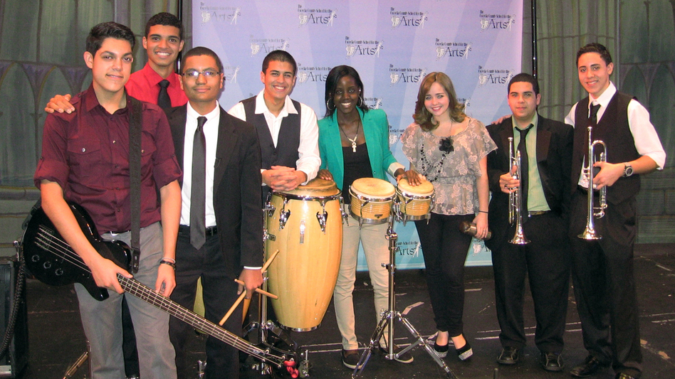 The young musicians of Seguro Que Si will perform in this weekend's Inaugural Parade. Left to right: Daniel Chico (bass), Kevin Arguelles (piano), Maxwell Frost (timbales), Christopher Muriel (congas), Niyah Lowell (bongos), Annette Rodriguez (vocal), Sean Fernandez (trumpet), Robby Cruz (trumpet). (NPR)