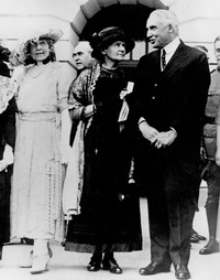 President Warren G. Harding speaks with Marie Curie at the White House. Before posing for photos outside, there was a ceremony in the East Room, but there wasn't enough light for the photographers.