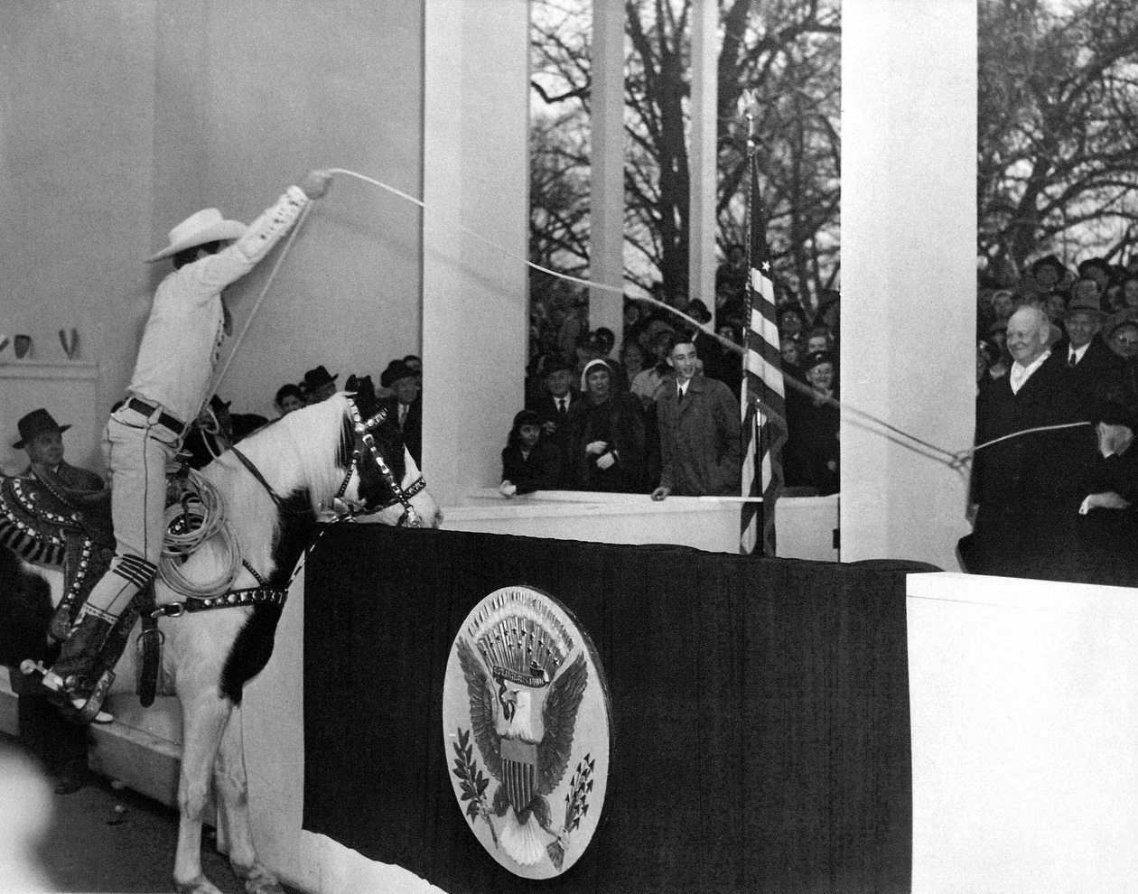 Television cowboy and roping legend Montie Montana lassoes President Eisenhower in the presidential reviewing box at the inaugural parade, 1953.