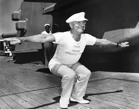 President Truman, wearing a shirt that reads