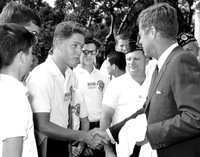 A young Bill Clinton meets President John F. Kennedy in the Rose Garden on July 26, 1963. Clinton, who was 16 years old at the time, was part of the Arkansas delegation to the American Legion Boys Nation.