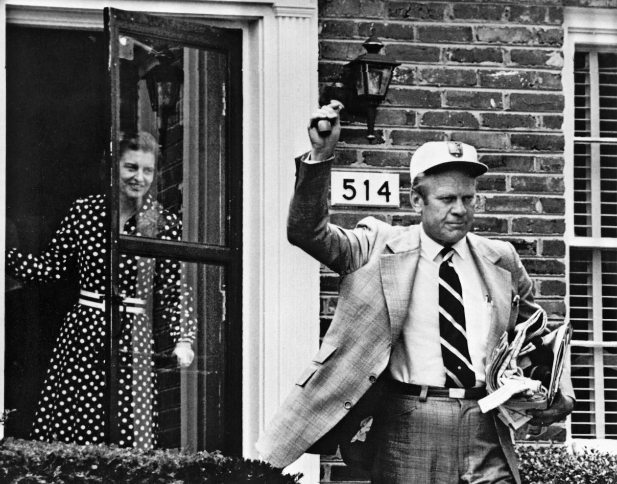 President Gerald Ford leaves his Alexandria, Va., home to go to work at the White House the day after he was sworn in. The Nixons' personal belongings had not yet been moved out of the White House living quarters.