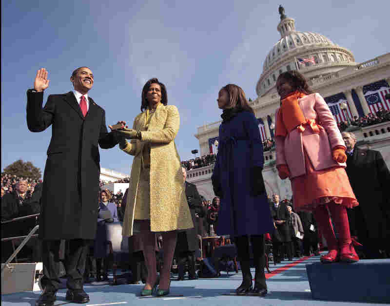 President Barack Obama takes the oath at his 2009 inauguration, with first lady Michelle Obama and their daughters, Malia and Sasha, by his side.