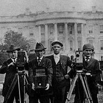 Photographers gather at the White House in 1918.
