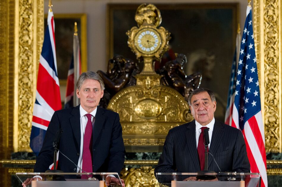 British Defense Minister Philip Hammond (left) and U.S. Defense Secretary Leon Panetta hold a joint press conference on the Algerian hostage crisis Saturday in London.