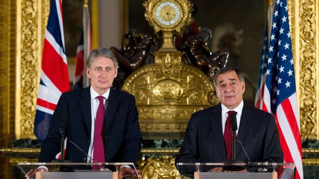 British Defense Minister Philip Hammond (left) and U.S. Defense Secretary Leon Panetta hold a joint press conference on the Algerian hostage crisis Saturday in London. (AFP/Getty Images)