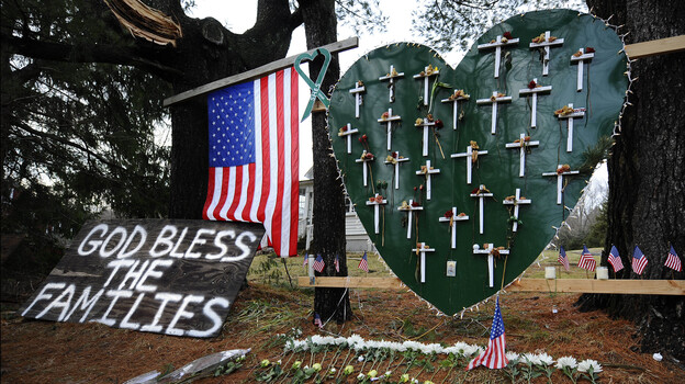 A memorial stands in a yard near the Sandy Hook Elementary School a month after the mass shooting that left 27 dead, including 20 children, in Newtown, Conn. (AP)