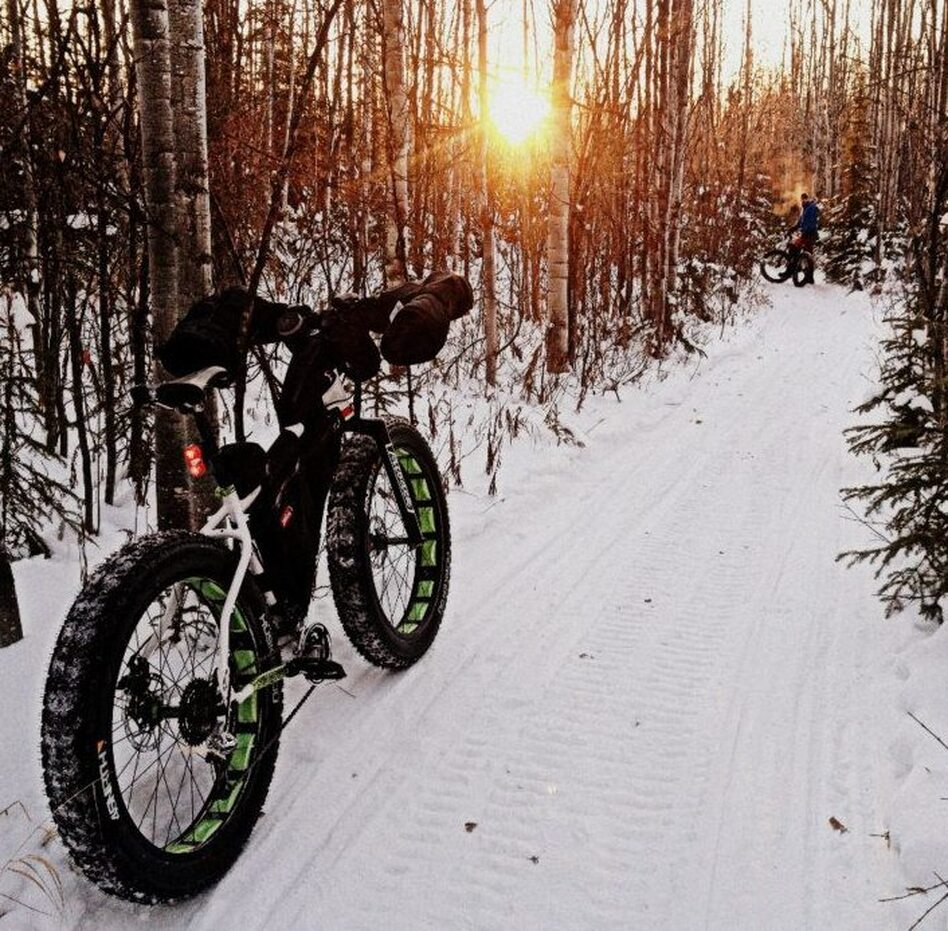 The wider tires on fat bikes roll over the snow better than regular mountain bikes. The first fat bikes were made by welding the rims of three mountain bike wheels together. (Josh Spice)