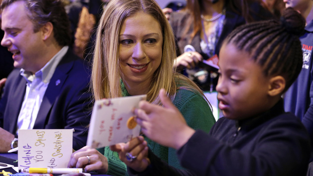 Chelsea Clinton makes cards with 8-year-old Addison Rose on the National Mall on Saturday as part of the National Day of Service events. Clinton, daughter of former President Bill Clinton and Secretary of State Hillary Clinton, is the honorary chair of the National Day of Service. (AP)