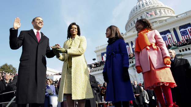 Barack Obama takes the oath of office beside his wife Michelle and daughters Sasha, right, and Malia, at the U.S. Capitol in Washington on Jan. 20, 2009. (AP)