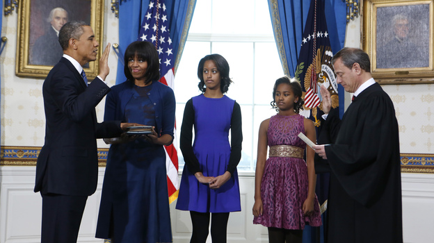 President Obama is officially sworn in Sunday by Chief Justice John Roberts in the Blue Room of the White House. Next to Obama are first lady Michelle Obama, holding the Robinson Family Bible, and their daughters, Malia and Sasha. (AP)