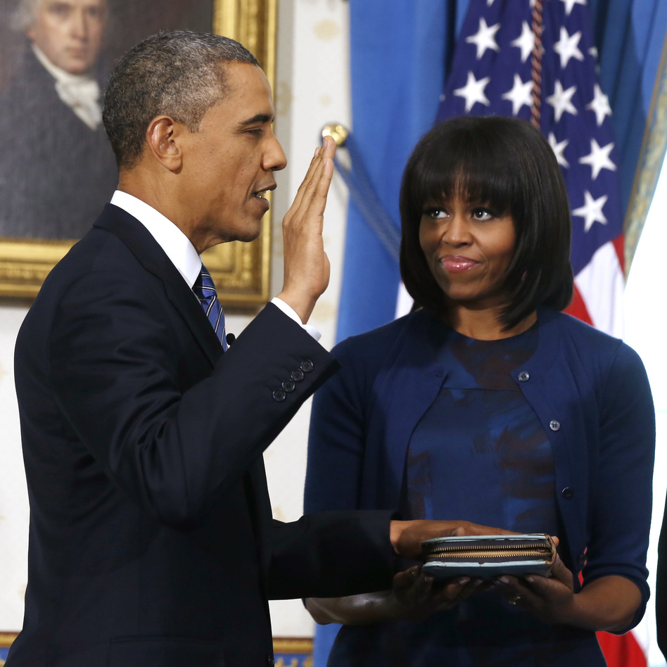 President Obama is officially sworn-in Sunday by Chief Justice John Roberts, as first lady Michelle Obama holds the Robinson family Bible. (AP)