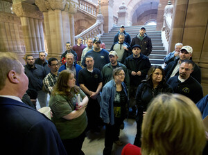 Workers from Remington Arms Company in Ilion, N.Y., talk with Assemblyman Marc Butler and Assemblywoman Claudia Tenney about gun legislation at the Capitol on Jan. 14 in Albany, N.Y.