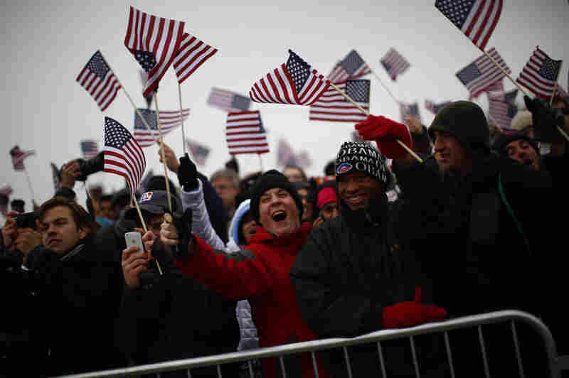 Spectators react on the National Mall during the 57th inauguration ceremony for President Obama.