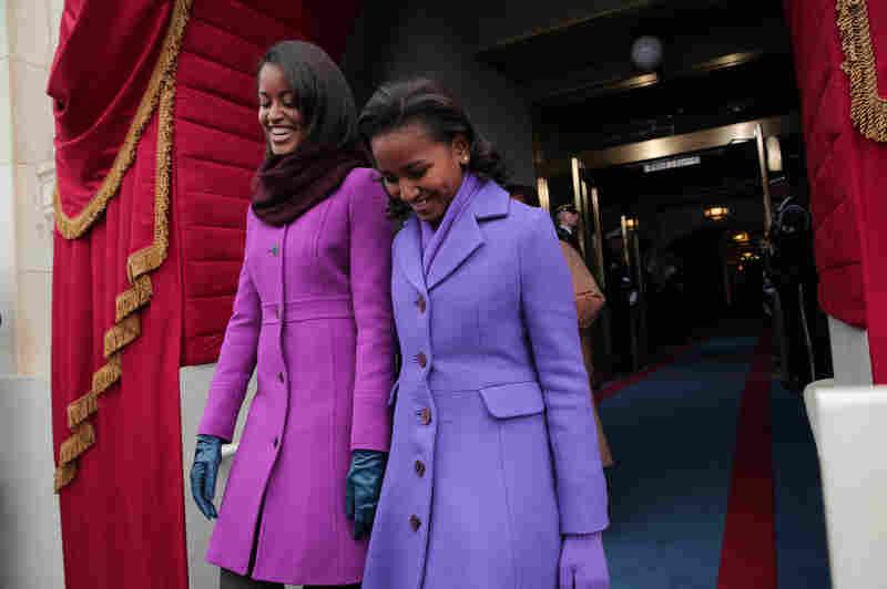 Malia Obama (left) is wearing a J.Crew coat; her sister, Sasha, wears a coat from American designer Kate Spade.