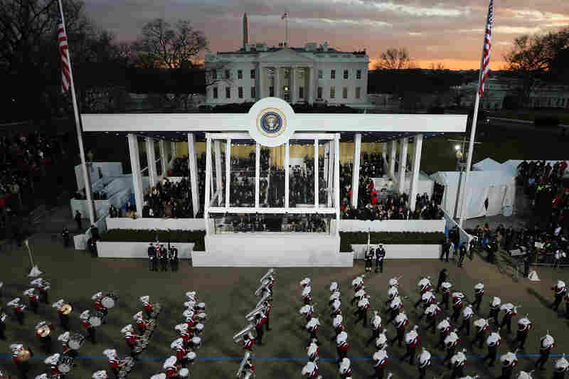 A marching band passes the presidential reviewing stand as the inaugural parade winds through the nation's capital.
