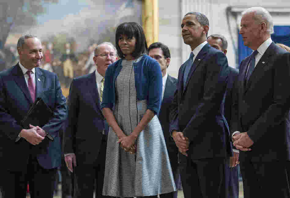 Vice President Biden, President Obama and Mrs. Obama pause to pay their respects at the Martin Luther King Jr. statue in the Capitol rotunda as they leave the inaugural luncheon. The first lady wore a cardigan she wore just the day before.