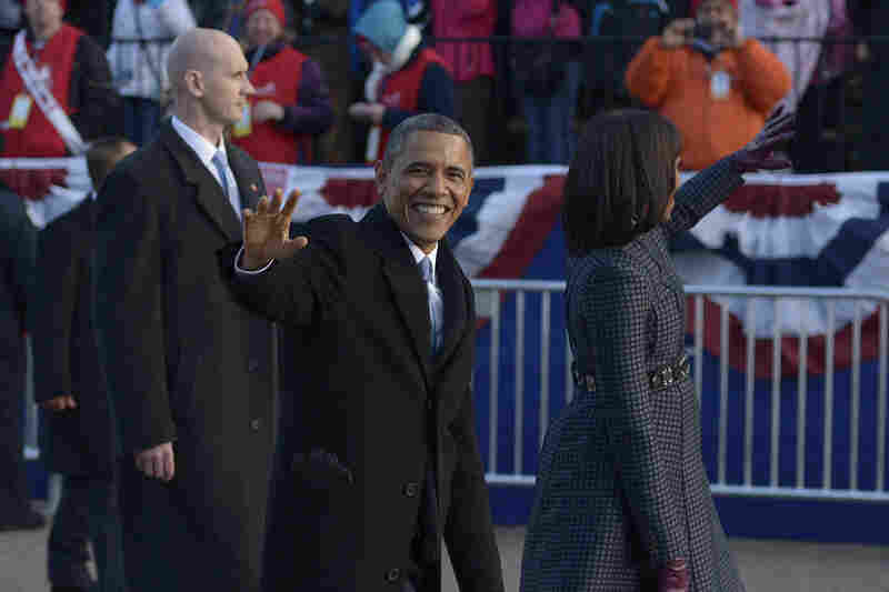 The president and first lady walk down the parade route after Obama was sworn in for a second term.