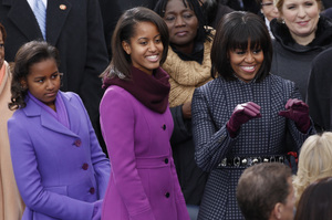 The first lady and her daughters arrive for the swearing-in of President Obama at the Capitol.