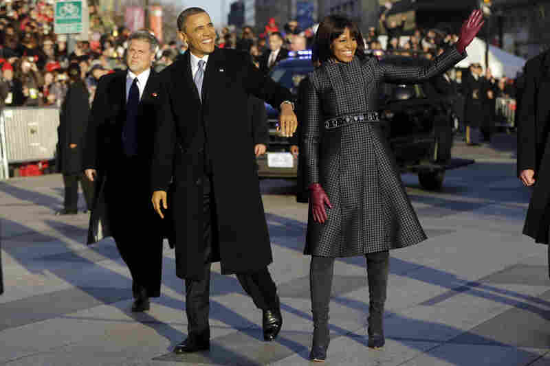 Obama and Michelle walk in the inauguration parade near the White House. The first lad