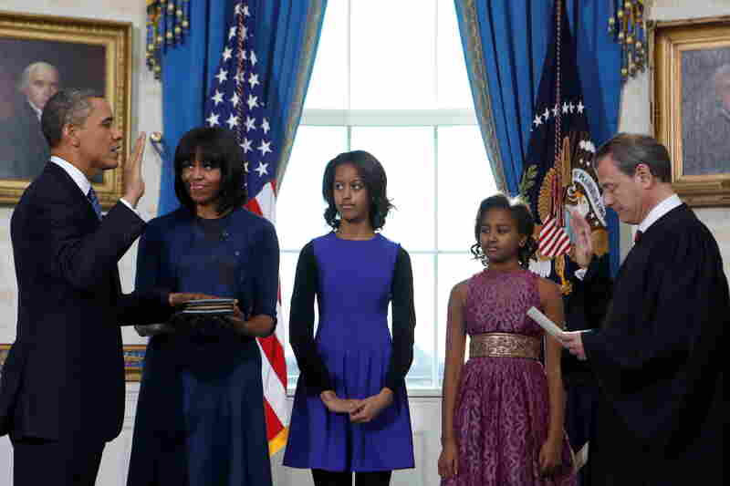 On Sunday, during the official swearing-in ceremony at the White House, the first lady wore a dress and cardigan by Reed Krakoff. Women's Wear Daily reports she wore the same cardigan on Monday.