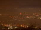 A haze of smoke hangs over Athens early Jan. 3. The hazy conditions result from residents' switch to wooden stoves and fireplaces for heating, as many households can no longer afford to buy heating oil.