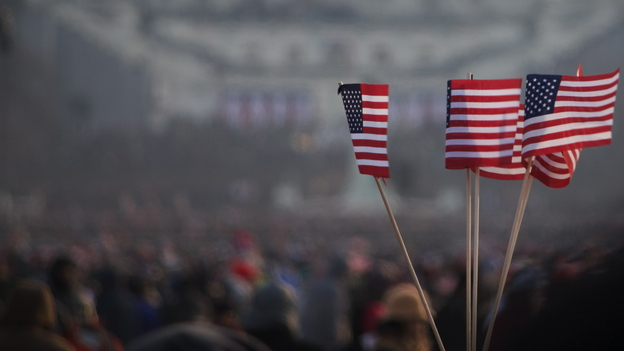 As a second-term president, Barack Obama necessarily generates less excitement than he did as a newcomer. Above, flags flew during his 2009 inauguration. (FlickrVision via Getty Images)