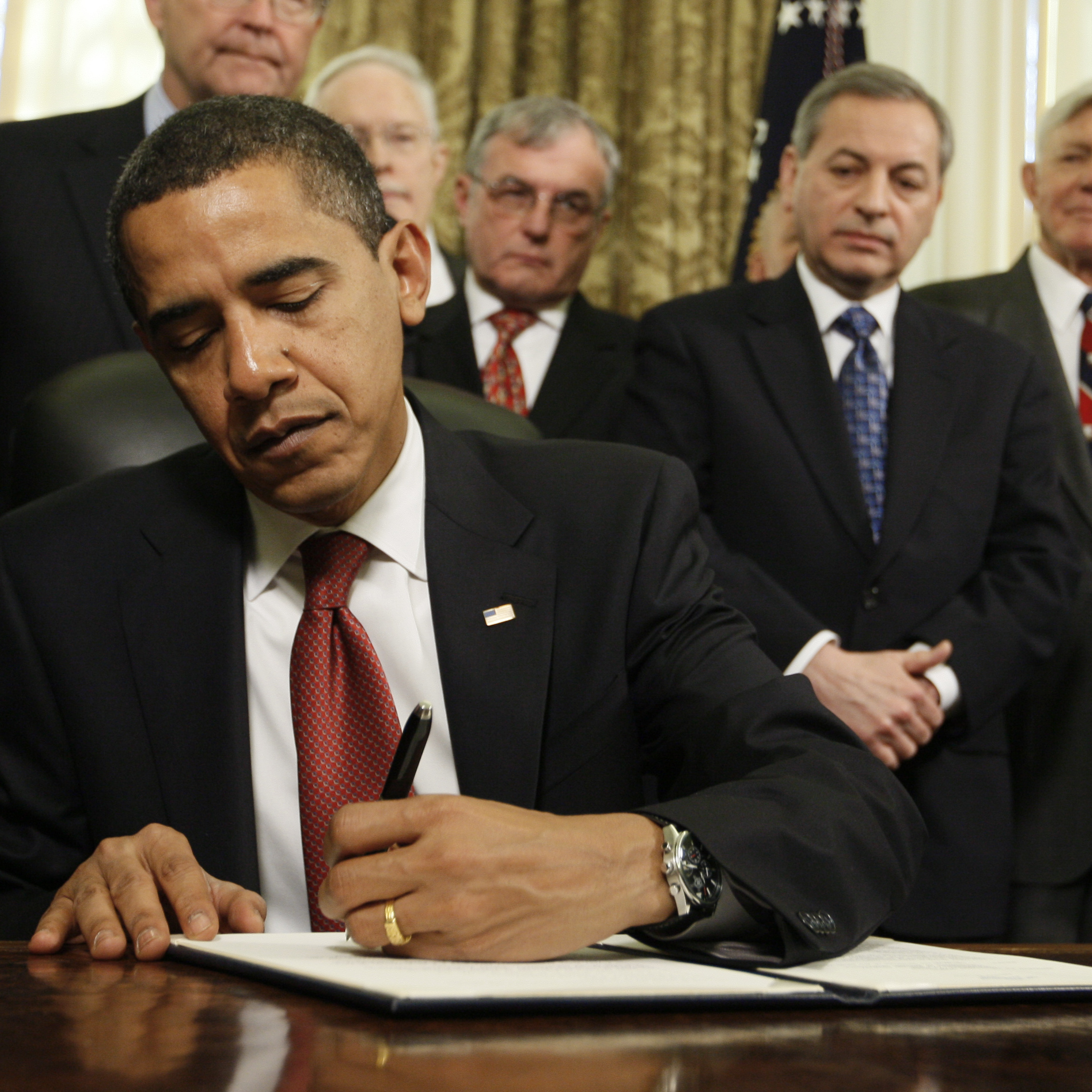 President Obama signs a series of executive orders on Jan. 22, 2009, including one closing the prison at Guantanamo Bay.