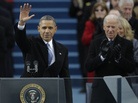 President Barack Obama waves after his speech while Vice President Joe Biden applauds at the ceremonial swearing-in at the U.S. Capitol during the 57th Presidential Inauguration in Washington on Monday.